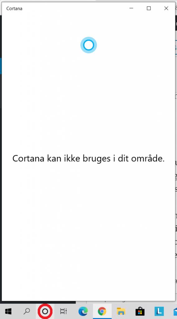 Cortana vises på proceslinjen (se den sorte cirkel inde i den røde cirkel) - men den virker ikke på dansk.